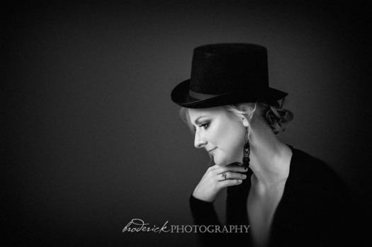 a portrait of a woman in a hat taken at my gold coast photography studio